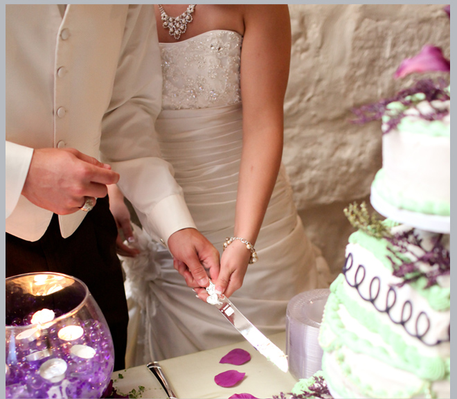 Bride and Groom Cutting Wedding Cake by Pedigo Photography