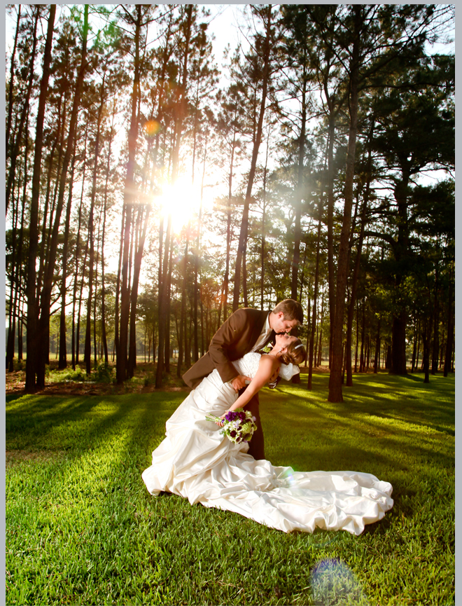 Bride and Groom Kiss in the Woods by Pedigo Photography