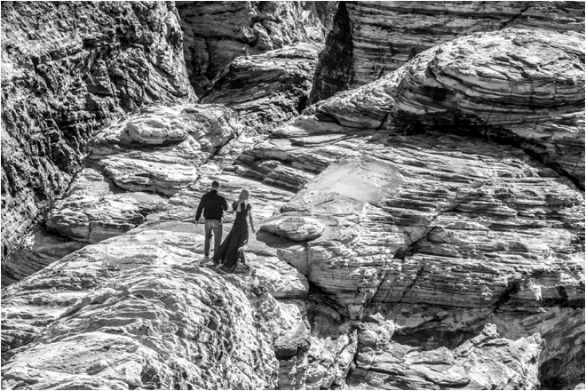 Couple walking on rock black and white