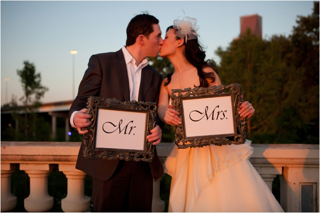 Bride and Groom kissing with Mr. & Mrs. signs