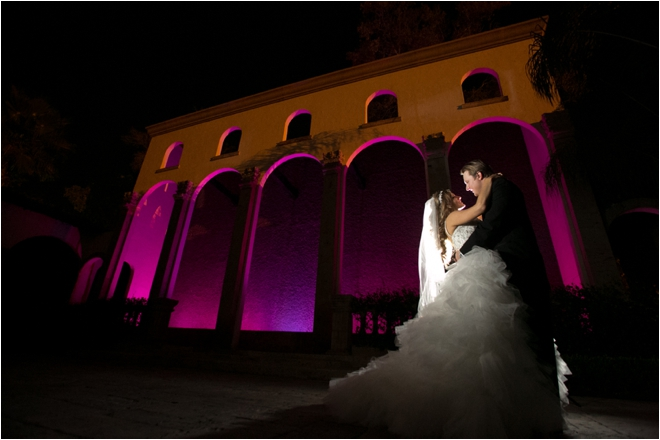 Bride and groom posing outside venue