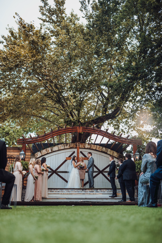 wedding ceremony at Hughes Manor