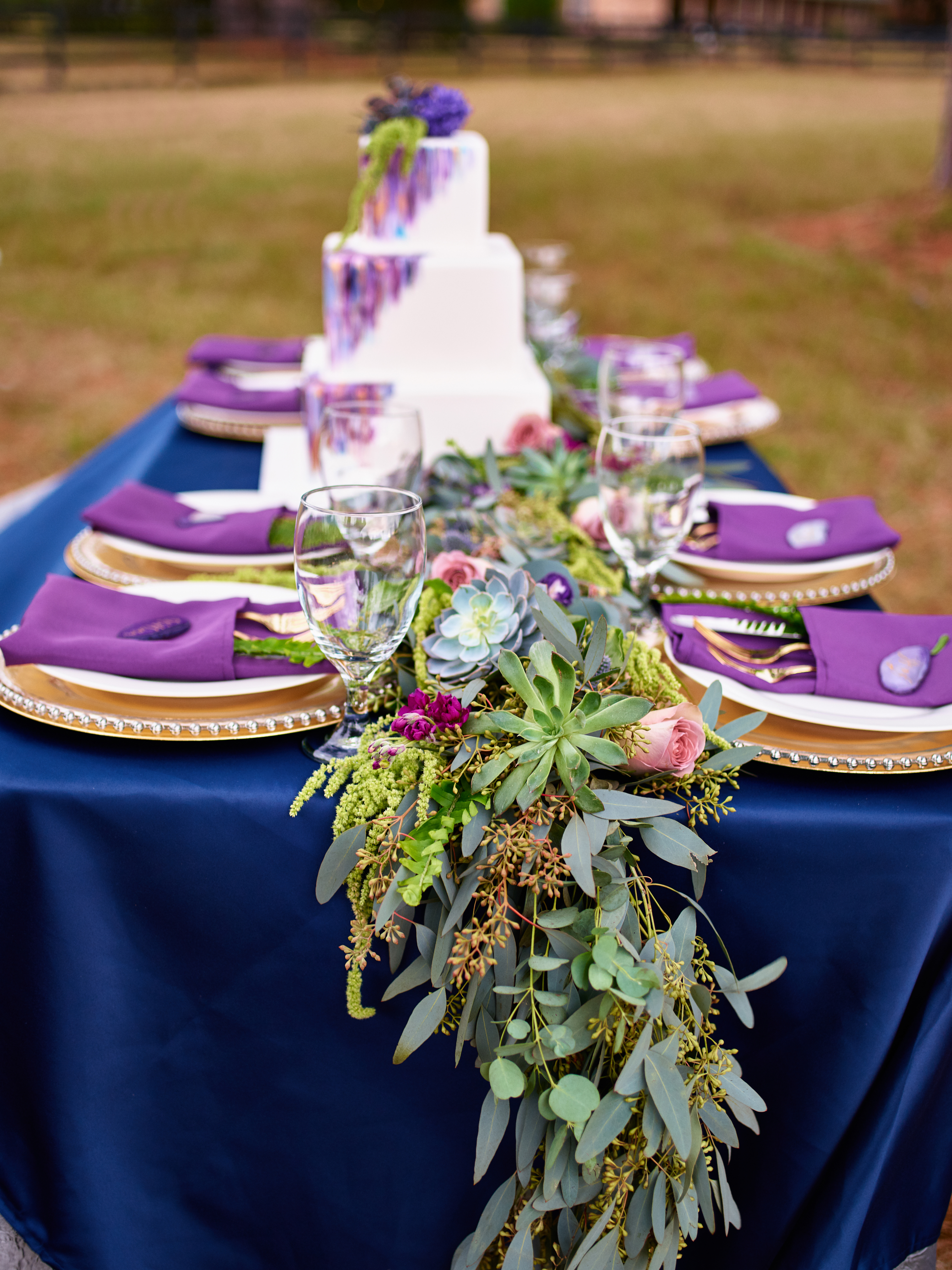 purple and gold styled wedding shoot beaded chargers eucalyptus succulents texas