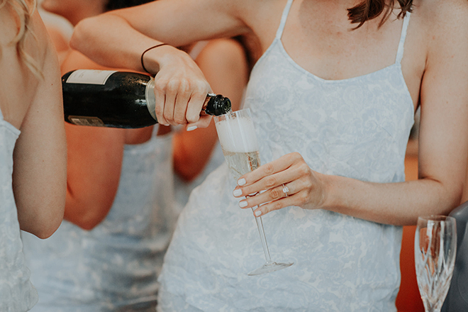 real wedding houston wedding the woodlands resort & conference center bridesmaids getting ready champagne toast diamond wedding ring