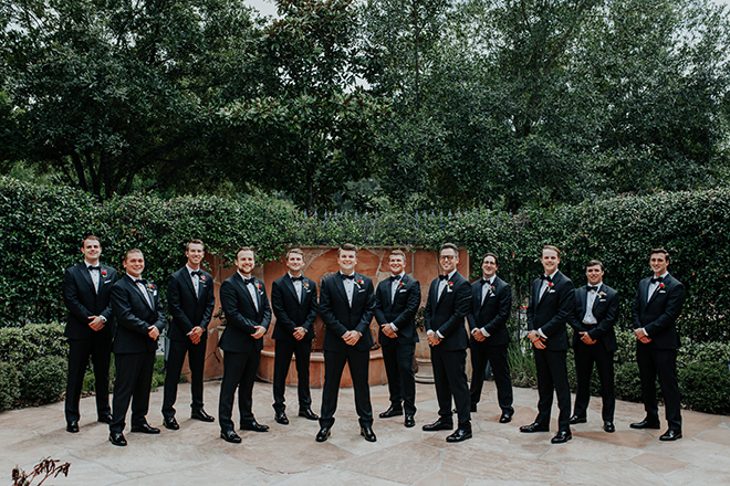 real wedding houston wedding the woodlands resort & conference center outdoor garden with fountain groom and groomsmen black tuxedos men's wedding attire