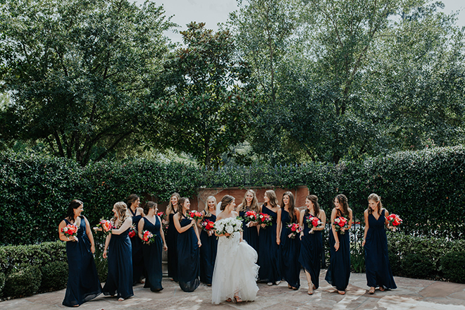real wedding houston wedding the woodlands resort & conference center outdoor garden bridal party blue bridesmaids dresses white bridal bouquet