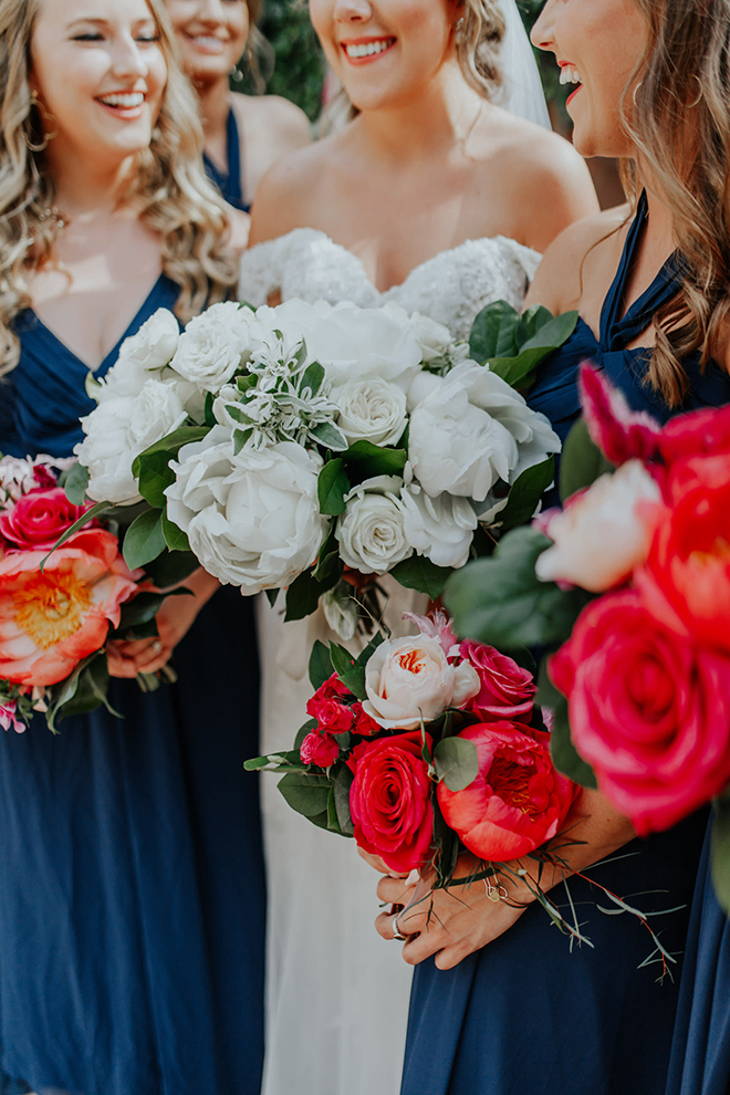 real wedding houston wedding the woodlands resort & conference center bridal bouquet white roses hot pink roses bridesmaids bouquets bridal party