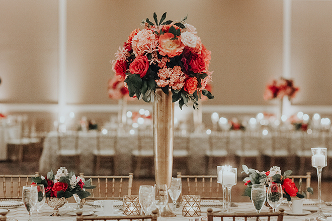 real wedding houston wedding the woodlands resort & conference center wedding reception decor pink and coral floral centerpiece gold vase gold chiavari chairs candlelit tables