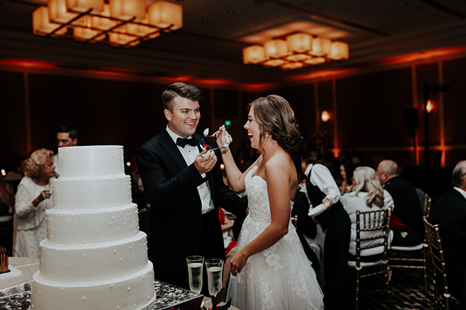 real wedding houston wedding the woodlands resort & conference center wedding cake tasting bride and groom white multi-tiered wedding cake