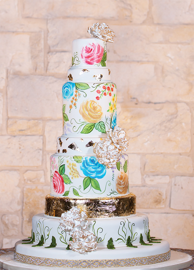 custom wedding cakes painted cake detailing blue yellow pink frost white and gold flowers gold trimming multi-tiered cake wedding cake inspiration Edible Designs