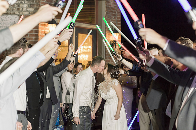 vintage haute flowers wedding, star wars, couple exit, sword salute, light sabers