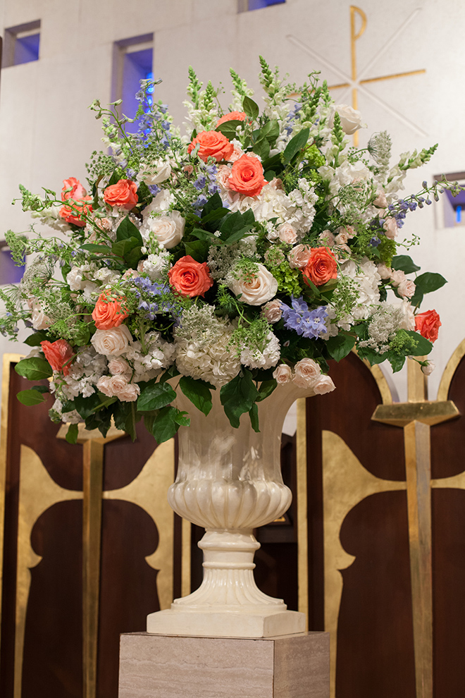 astorian spring wedding, wedding ceremony decor, coral and blue flower arrangement, church wedding ceremony
