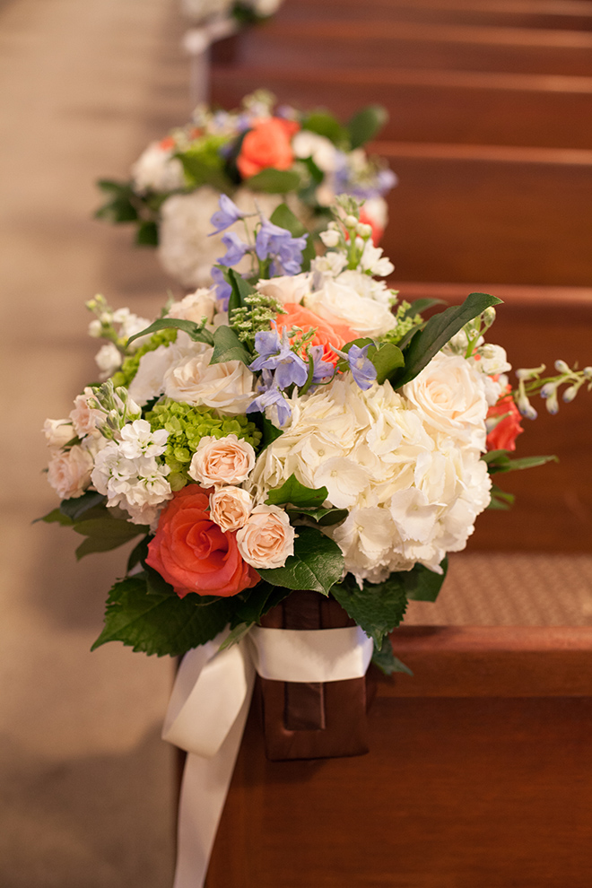 astorian spring wedding, wedding ceremony decor, coral, ivory and blue flower arrangement, church wedding ceremony, pew decorations