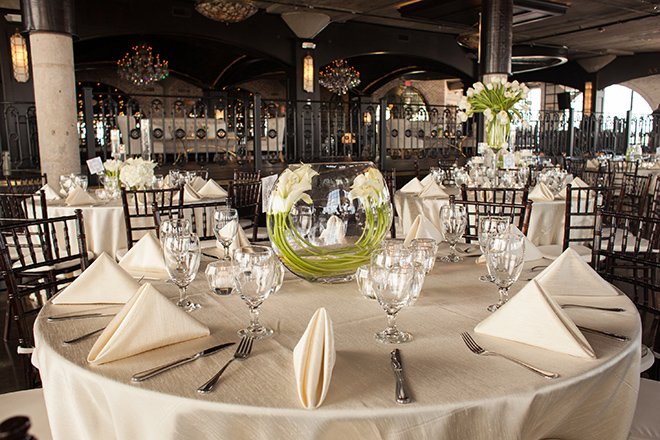 astorian spring wedding, downtown houston wedding venues, white wedding reception decor, dark brown chiavari chairs, the astorian, folded napkins, floral table centerpiece