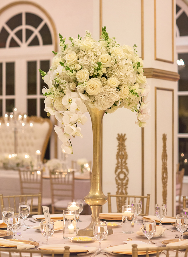 houston wedding, chateau cocomar, white and gold decor, wedding reception, floral centerpiece with white flowers, wedding reception decor, luxe chateau cocomar wedding