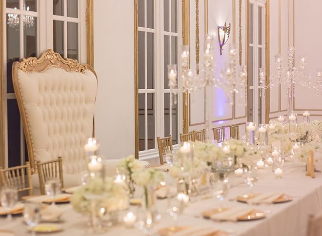 houston wedding, chateau cocomar, white and gold decor, wedding reception, floral centerpiece with white flowers, wedding reception decor, crystal chandeliers, luxe chateau cocomar wedding