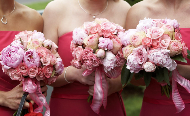 pink blush wedding bouquets peonies roses ribbon tied
