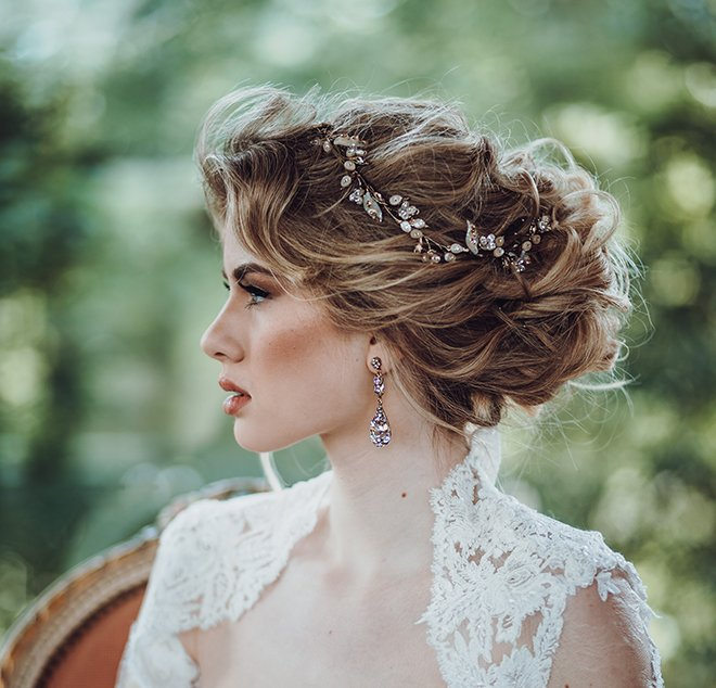 bridal hair and makeup wedding beauty houston stylists makeup artists textured updo curly hair low bun maria elena headpiece bridal hair accessory