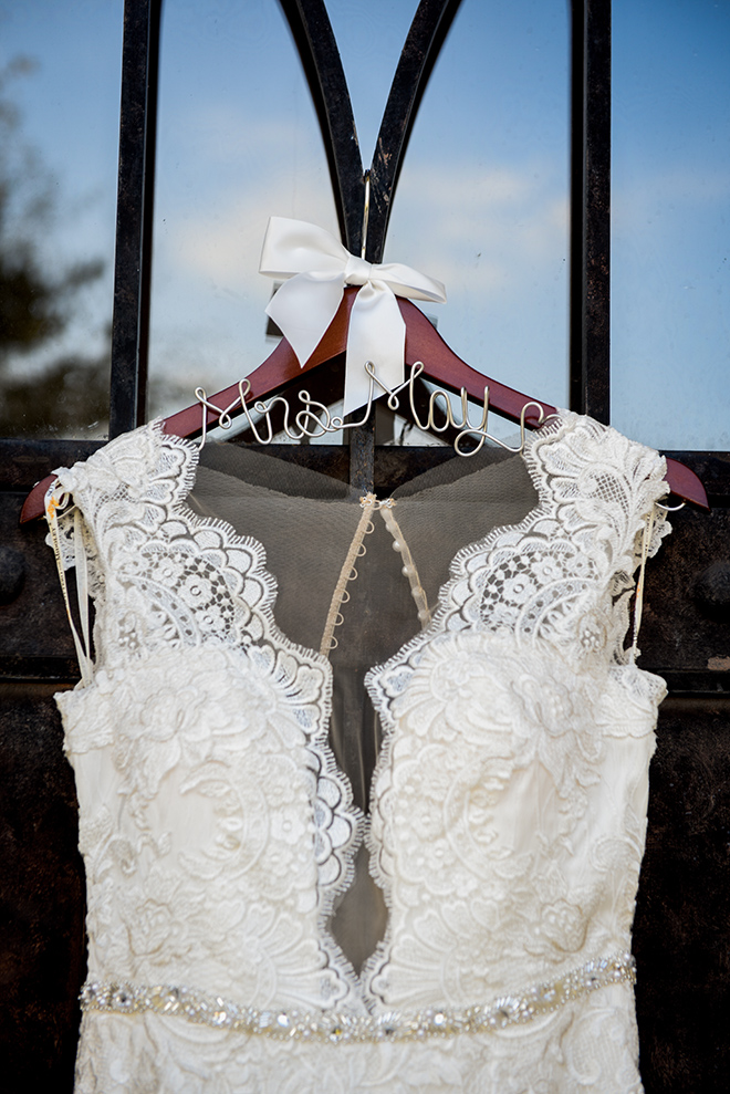 rustic autumn wedding, briscoe manor, kiss and makeup houston, custom wedding dress hanger, white lace wedding dress with beaded waist-line