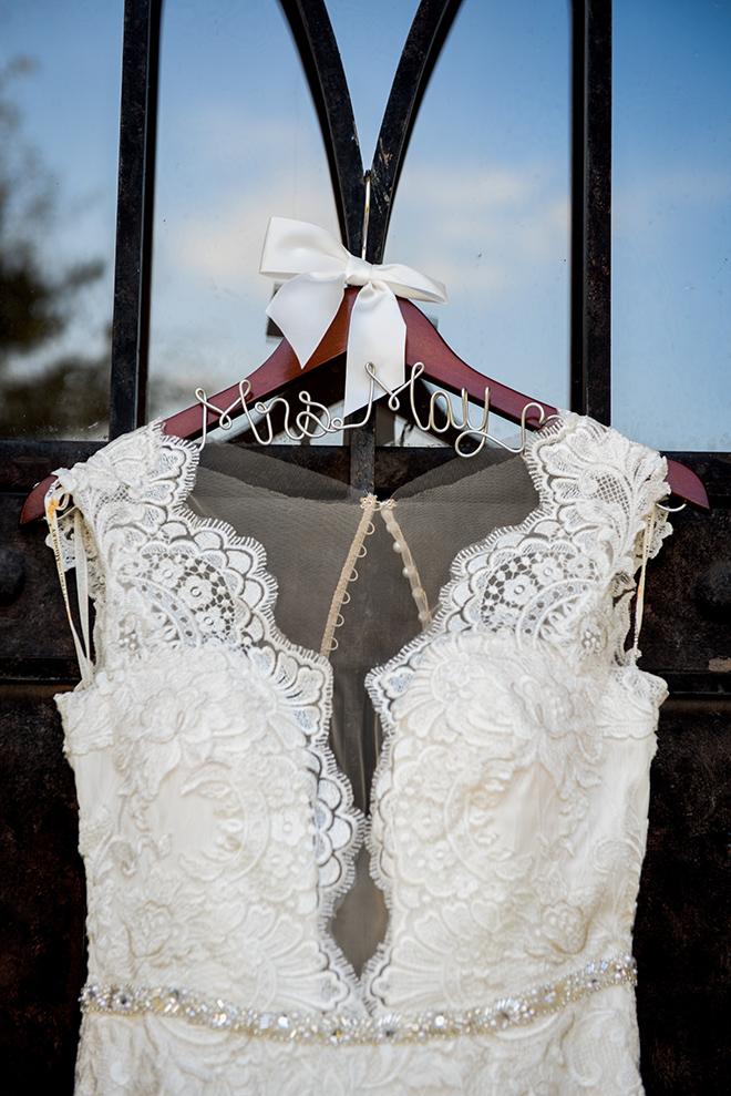 rustic autumn wedding, briscoe manor, kiss and makeup houston, custom wedding dress hanger, white lace wedding dress with beaded waist-line