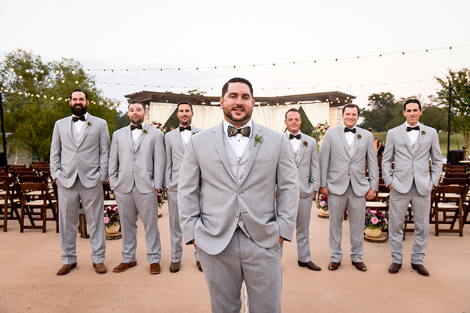 rustic autumn wedding, briscoe manor, kiss and makeup houston, outdoor wedding ceremony, string lights, groom, groomsmen, gray men's suits