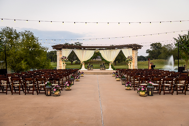 rustic autumn wedding, briscoe manor, kiss and makeup houston, outdoor wedding ceremony, string lights, harp player, lanterns