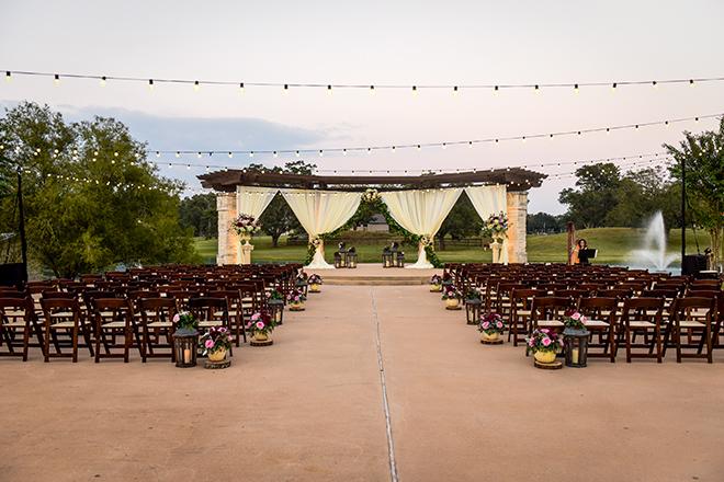 rustic autumn wedding, briscoe manor, kiss and makeup houston, outdoor wedding ceremony, string lights, harp player, lanterns