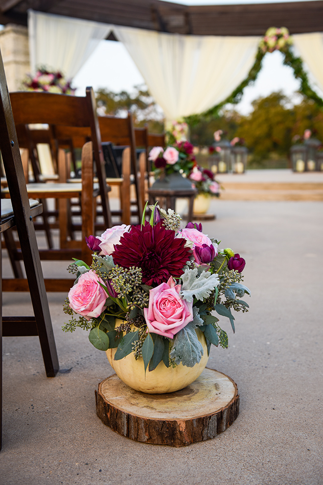 rustic autumn wedding, briscoe manor, kiss and makeup houston, outdoor wedding ceremony, string lights, burgundy and pink arrangements