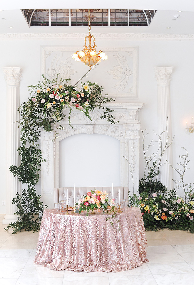 royal wedding inspired shoot, chateau cocomar, jessica frey photography, spring florals, regal wedding decor, blush and gold table setting, white marble, reception decor, houston wedding venue