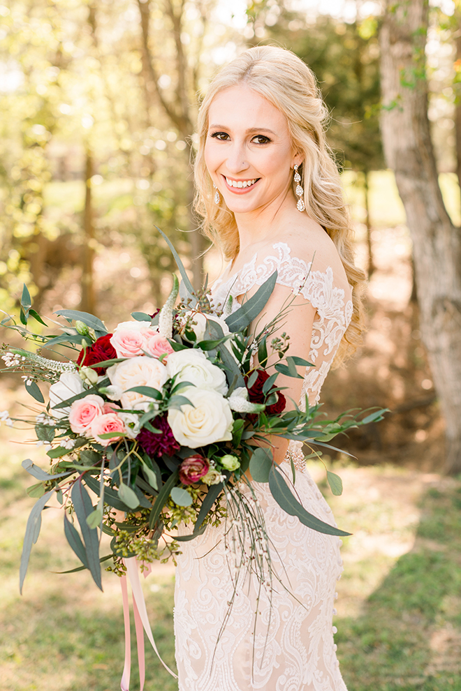 texas barn wedding haute flowers bouquet eucalyptus red pink cream greenery