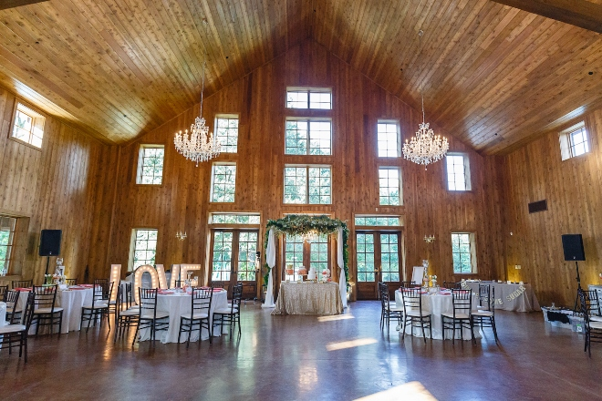 houston conroe elegant barn weddings rustic venue chandeliers wood windows chapel