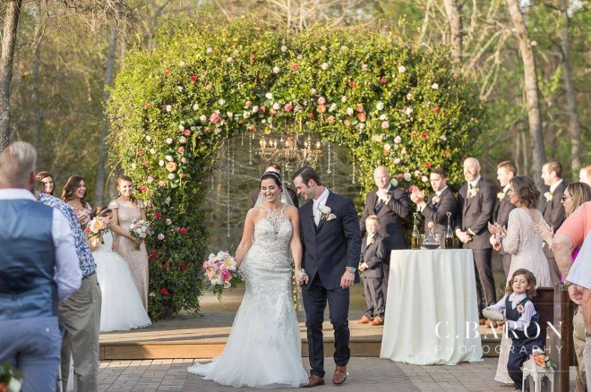 outdoor arbor ceremony forest pond fountain elegant barn weddings carriage house conroe