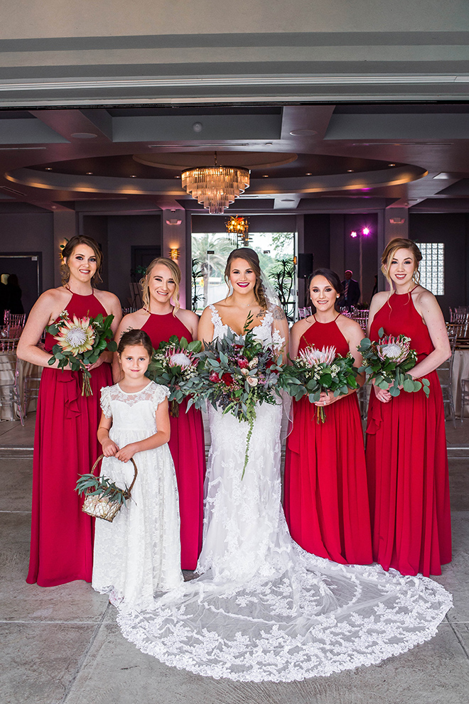 red bridesmaids dresse greenery bouquets