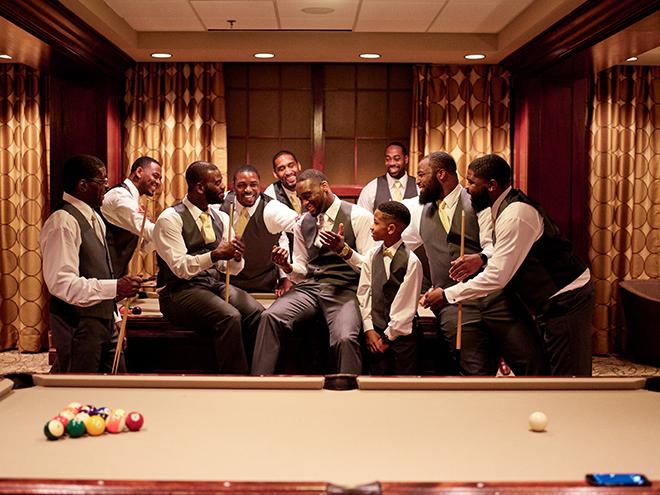 galveston wedding groom groomsmen pool table suite
