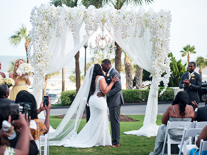 outdoor ceremony galveston wedding white canopy flowers lawn