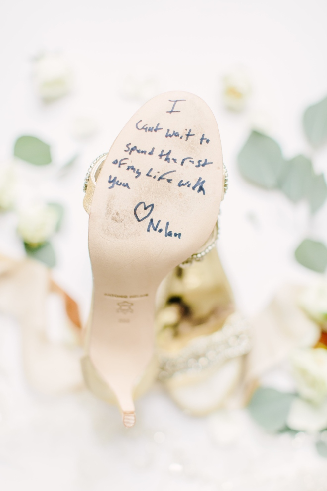 white green and gold winter wedding ashton gardens detail photo bridal shoe sole message love note