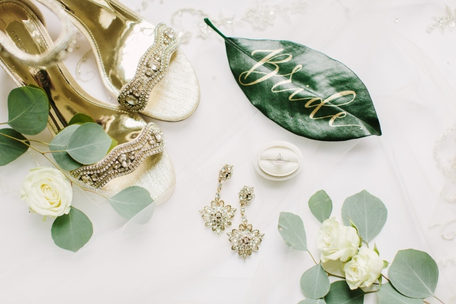 white green gold ashton gardens houston wedding detail image jewelry shoes bride
