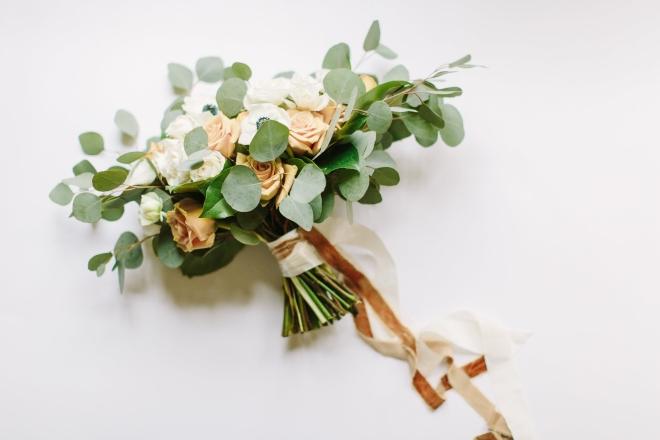 ashton gardens gold winter wedding hand tied bouquet eucalyptus rose ribbon