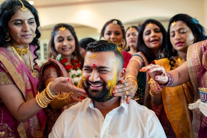 hindu-muslim wedding bridesmaids groom paint mehendi
