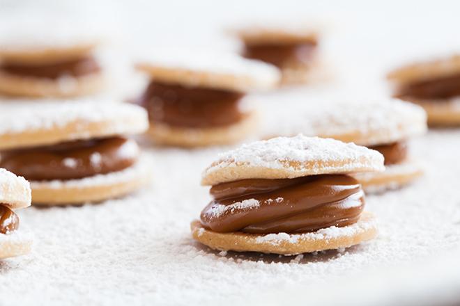 Mini dulce de leche cookie dessert alfajores by Churrasco's - Cordua Catering