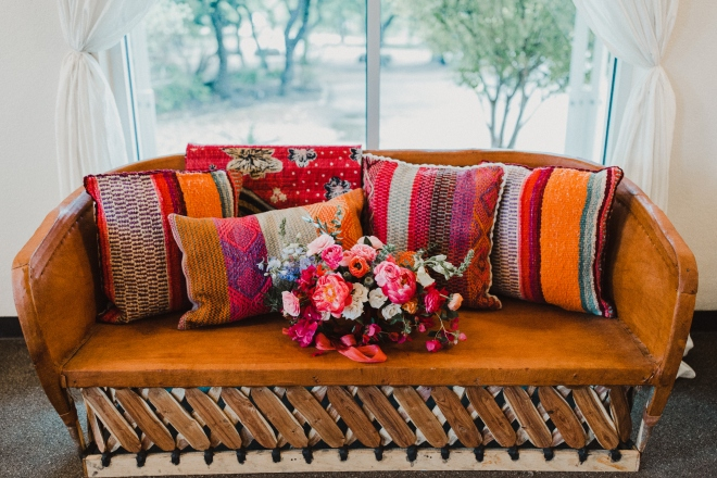 terrace club wedding dripping springs hill country boho desert chic couch orange blue red