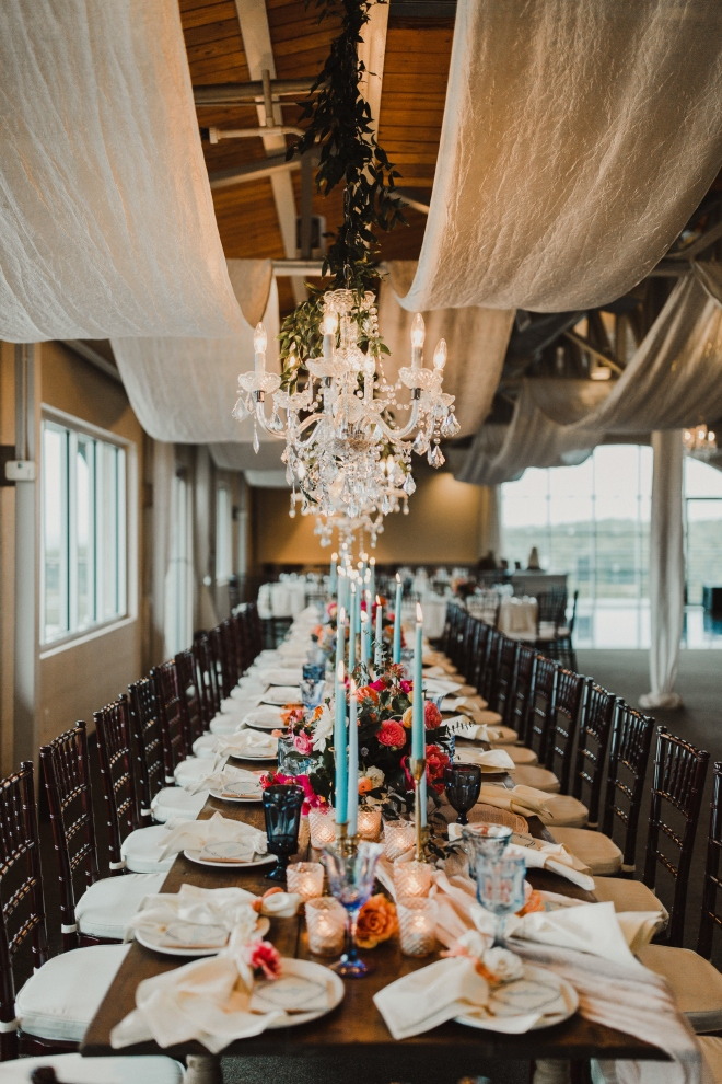 terrace club dripping springs rustic elegant farm table wedding reception blue candles chandeliers