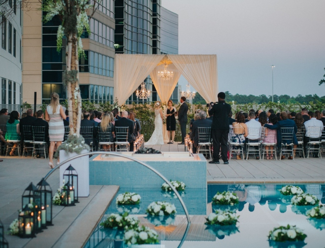 rooftop wedding ceremony houston the woodlands chandelier pool terrace modern wedding venue
