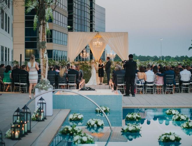 rooftop wedding ceremony houston the woodlands chandelier pool terrace modern wedding venue