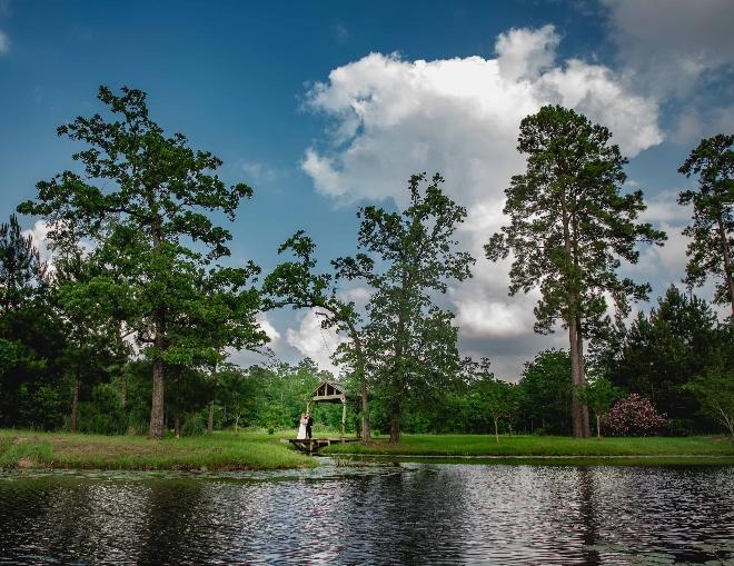houston destination wedding venue lake pond water view engagement photos