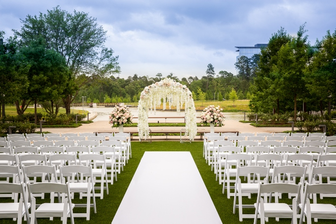 outdoor ceremony lawn lake flower canopy new hotel marriott cityplace springwoods