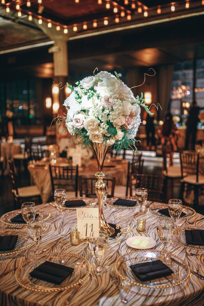 classic wedding centerpiece white blush greenery vines gold tall vase