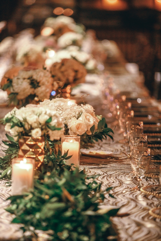 low centerpiece banquet table wedding reception gold textured linen houston texas