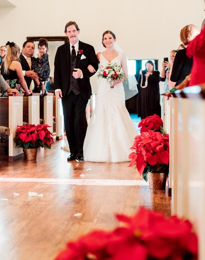 briscoe manor christmastime wedding houston ceremony limestone chapel poinsettias