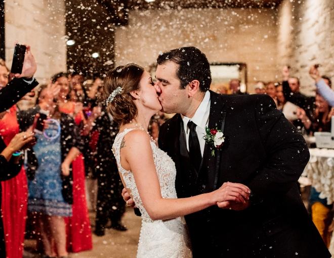 christmastime wedding snowfall exit